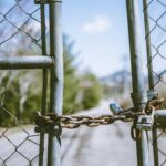 cyclone fence in shallow photography